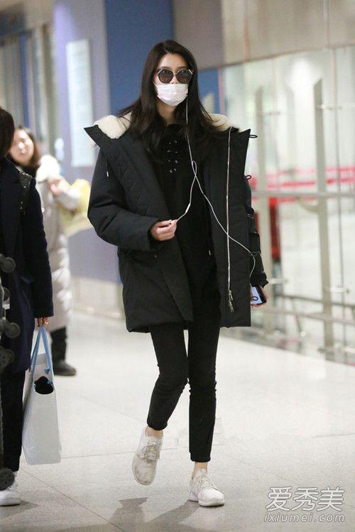 华语女星机场街拍 倪妮裹成球何洁狂露腿图片